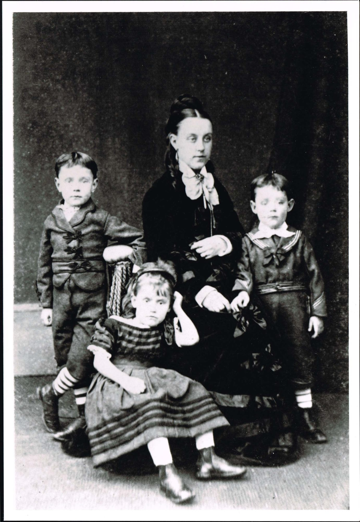 Black and white photograph of Agnes Cayzer with her three eldest children, Charles, Mamie and Jack in 1873