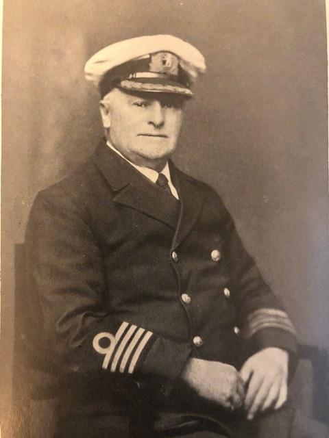 Photographic portrait of Captain Phillips, in Clan Line Captain's Uniform